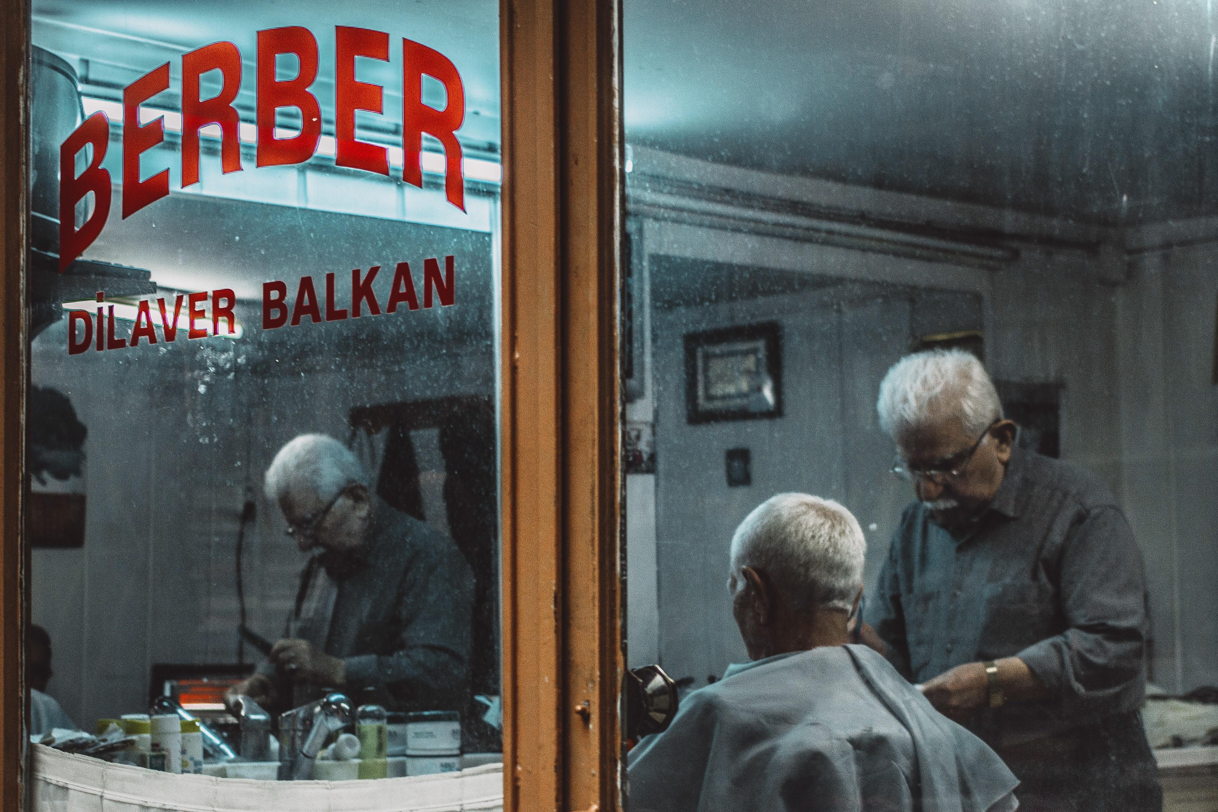 Older man working as barber