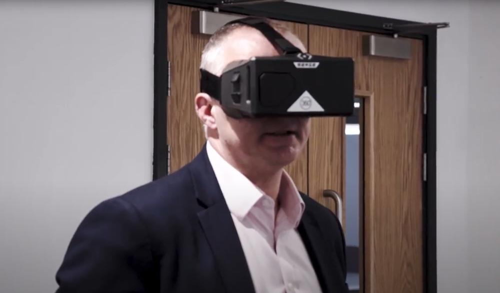 Man in suit wearing VR headset